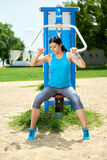 Attractive brunette woman exercising in outdoor Stock Photography