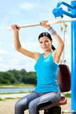 Attractive brunette woman exercising in outdoor Stock Image
