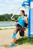 Attractive brunette woman exercising in outdoor Royalty Free Stock Photo
