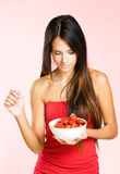 Attractive brunette woman with fresh strawberries. Royalty Free Stock Photo