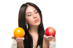 Attractive brunette woman with  fruit Royalty Free Stock Image