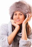 Attractive brunette woman in a fur hat Royalty Free Stock Images