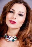 Attractive brunette woman with glamour jewellry Stock Image