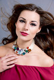 Attractive brunette woman with glamour jewellry Stock Photography