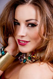 Attractive brunette woman with glamour jewellry Stock Images