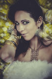 Attractive brunette woman with gold jewelry sexy dancing in a ni Royalty Free Stock Photography
