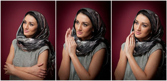 Attractive brunette woman in gray blouse and headscarf posing dramatic on purple background. Female art portrait, studio shot Royalty Free Stock Photo