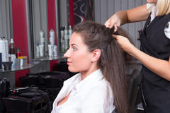 Attractive brunette woman in hairdressing salon Royalty Free Stock Images