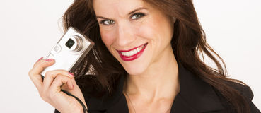 Attractive Brunette Woman Happy Taking Point and Shoot Camera Stock Photos