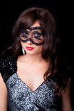 Attractive brunette woman with lacy mask Royalty Free Stock Image
