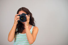 Attractive brunette woman-photographer. Stock Photos