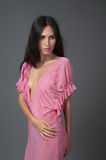 Attractive brunette woman in pink dress Royalty Free Stock Image