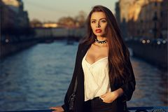 Free Attractive Brunette Woman Posing Against River On Background Royalty Free Stock Photos - 100593328