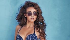 Attractive brunette woman posing in studio Stock Image