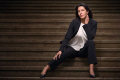 Attractive brunette woman posing on urban stairs Stock Photo