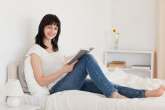 Attractive brunette woman reading a book Royalty Free Stock Images