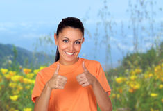 Attractive brunette woman saying Ok in the field Stock Photo