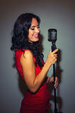 Attractive brunette woman singing. Royalty Free Stock Photo