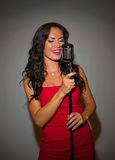 Attractive brunette woman singing. Stock Photo