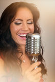 Attractive brunette woman singing. Royalty Free Stock Image
