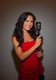 Attractive brunette woman singing. Royalty Free Stock Photography