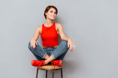 Attractive brunette woman sitting on the chair Stock Photo