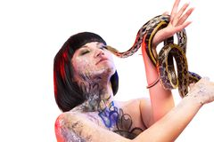 Attractive brunette woman with snake Stock Images