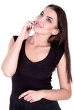 Attractive Brunette Woman Talking on Her Cell Phone Isolated white - Stock Image Royalty Free Stock Photography