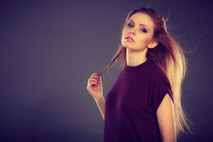 Attractive brunette woman with windblown hair Stock Images