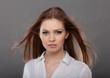 Attractive brunette woman with windblown hair Stock Photos