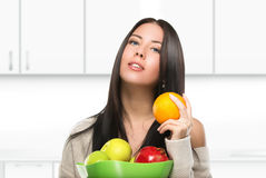 Attractive Brunette Woman With Bowl Of Fruit In Stock Images