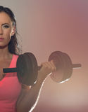 Attractive brunette woman working out. Stock Image