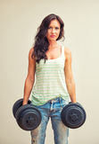 Attractive brunette woman working out. Royalty Free Stock Photography