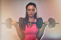 Attractive brunette woman working out. Stock Photography