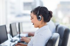 Attractive brunette working in a call centre Stock Photos