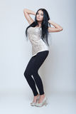 Attractive brunette young girl fashion style long leg Royalty Free Stock Photos