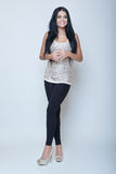 Attractive brunette young slim girl fashion style long leg and h Stock Image