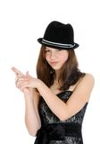 Attractive brunette young teenage girl with hand in shape of a gun Royalty Free Stock Photography
