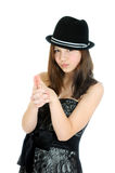 Attractive brunette young teenage girl with hand in shape of a gun Stock Photos