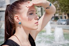 Attractive brunette young woman in summer outdoor Stock Photos