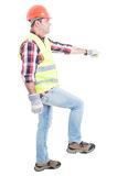Attractive builder doing one step Royalty Free Stock Photography