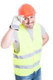 Attractive builder man holding helmet acting polite Stock Image