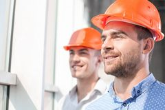 Attractive builders are dreaming about future Royalty Free Stock Image