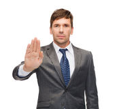 Attractive buisnessman making stop gesture Royalty Free Stock Images