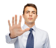 Attractive buisnessman making stop gesture Royalty Free Stock Photo