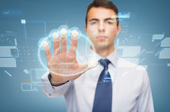 Attractive buisnessman working with virtual sceen. Business and office, ban, veto, warning concept - attractive buisnessman working with virtual screen Stock Photos