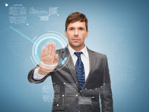 Attractive buisnessman working with virtual screen Stock Image