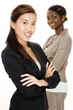 Attractive Business. An asian business woman standing in front of her colleague Stock Images