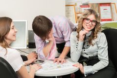 Attractive business lady smiles in office Stock Photos