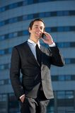 Attractive business man calling by cellphone outdoors Stock Photo